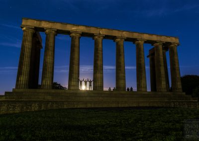 Moonrise behind The Scottish National Monument
